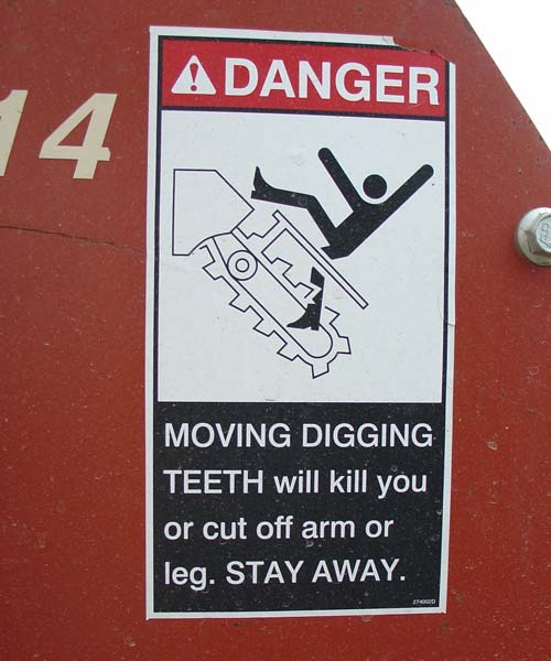 [ Image: The Ditch Witch Warning Label: Danger! MOVING DIGGING TEETH will kill you or cut off arm or leg. STAY AWAY. ]
