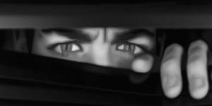 [ Image: Black and white illustration of the upper half of a man's suspicious, paranoid face ]